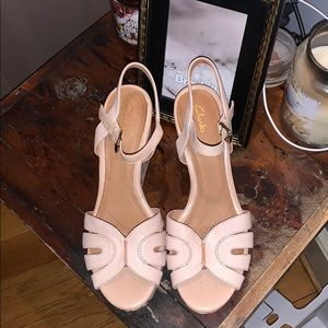 Pink wedges with ankle strap made by Clarks